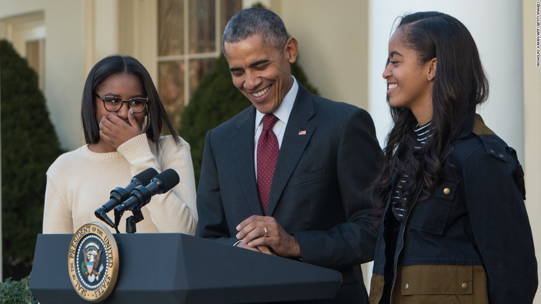 "Making a few jokes, President Barack Obama laughs with his daughters, Malia and Sasha, before ""pardoning"" Abe, the National Thanksgiving Turkey, in the Rose Garden at the White House in Washington, D.C., on November 25, 2015."