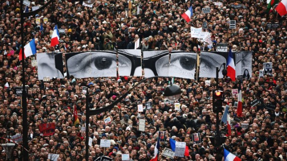 January 11: The eyes of Charlie Hebdo editor Stephane Charbonnier appear at an anti-terrorism rally in Paris. More than a million people took part in the demonstration, a gesture of unity just days after Charbonnier and 16 others were slaughtered.