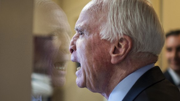 January 13: U.S. Sen. John McCain fools around with colleagues upon arriving at a news conference in Washington.