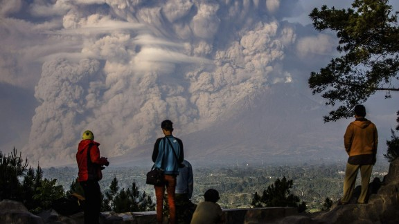 February 9: People watch as the Mount Sinabung volcano shoots ash into the air during an eruption in Karo, Indonesia. See other recently active volcanoes