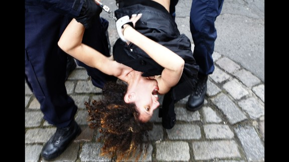 February 10: An activist from the Ukrainian feminist group Femen is arrested by police in Lille, France, after protesting in front of the convoy of Dominique Strauss-Kahn. Strauss-Kahn, the former chief of the International Monetary Fund, was on trial for aggravated pimping charges. He was acquitted in June.
