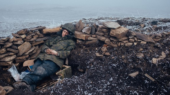 February 15: A pro-Russian rebel rests in Debaltseve, Ukraine, one day after a skirmish with Ukrainian troops. Fighting between Ukrainian troops and pro-Russian rebels has left more than 6,000 people dead since April 2014, according to the United Nations. A recent ceasefire, the so-called Minsk Agreement, has been repeatedly violated.