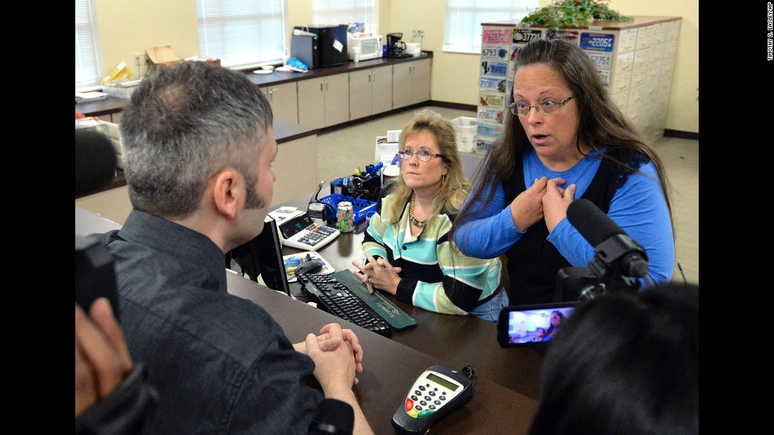 "<strong>September 1:</strong> Rowan County Clerk Kim Davis, right, talks with David Moore after she refused him a marriage license in Morehead, Kentucky. Davis was eventually jailed for <a href=""http://www.cnn.com/2015/09/14/politics/kim-davis-same-sex-marriage-kentucky/index.html"" target=""_blank"">refusing to issue marriage licenses to same-sex couples.</a> She said same-sex marriages violated her Christian beliefs. After her release, she said she would not issue any marriage licenses that go against her religious beliefs. But she left the door open for her deputies to give out marriage licenses to same-sex couples as long as those documents do not have her name or title on them."