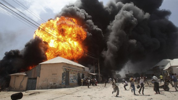 February 23: People run from an explosion at a gas station and storage facility near the Bakara market in Mogadishu, Somalia.