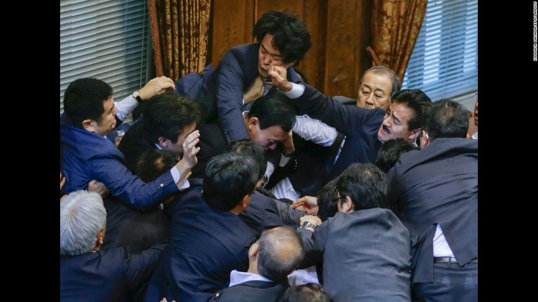 "<strong>September 17:</strong> <a href=""http://www.cnn.com/videos/world/2015/09/17/japan-parliament-scuffle-over-bill.cnn"" target=""_blank"">A fight breaks out</a> between Japanese lawmakers in Tokyo as they prepare to vote over controversial security legislation that would allow Japanese troops to be deployed overseas."