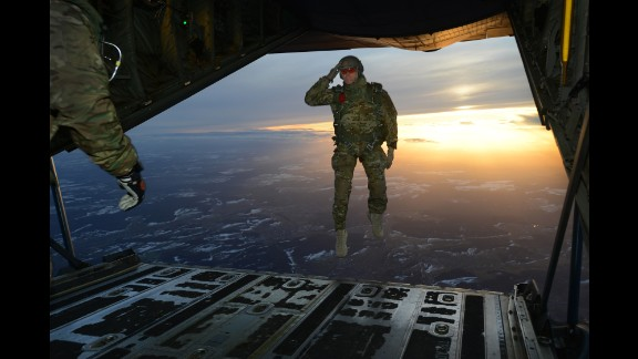 February 24: A U.S. soldier salutes while jumping out of an aircraft in Germany.