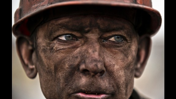 March 4: A Ukrainian coal miner waits for a bus after exiting the Zasyadko mine, where he helped search for the bodies of his colleagues in Donetsk, Ukraine. Thirty-three workers were killed after an early morning explosion at the mine.