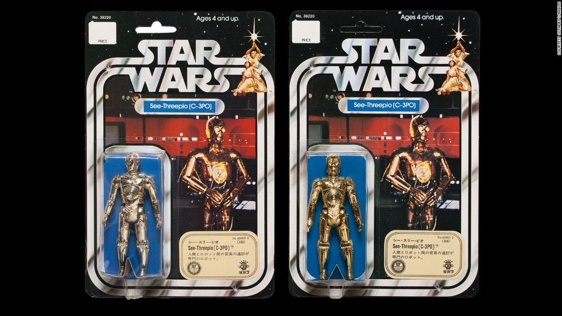 Made for the Japanese market, these Takara C-3PO figures from 1978 some with the full phonetic spelling on the backing card. In a field in which defects are welcomed for their rarity, the off-color C-3PO on the left probably increased this lot's value.