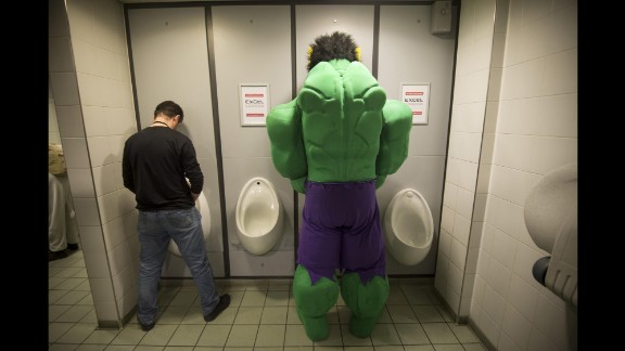 March 14: A man dressed as the Incredible Hulk uses the restroom during the London Super Comic Convention.