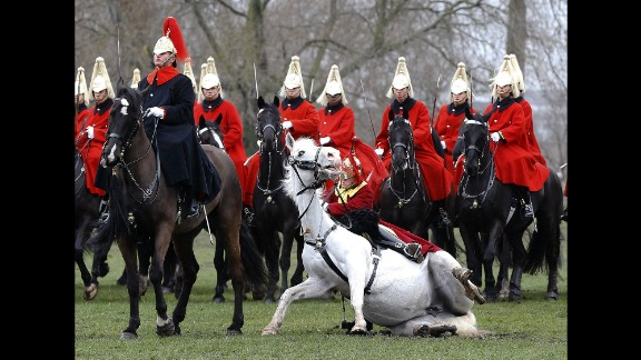 March 26: A trumpeter falls off his horse as the Household Cavalry Mounted Regiment parades in London's Hyde Park. The British Army regiment was undergoing its annual inspection.