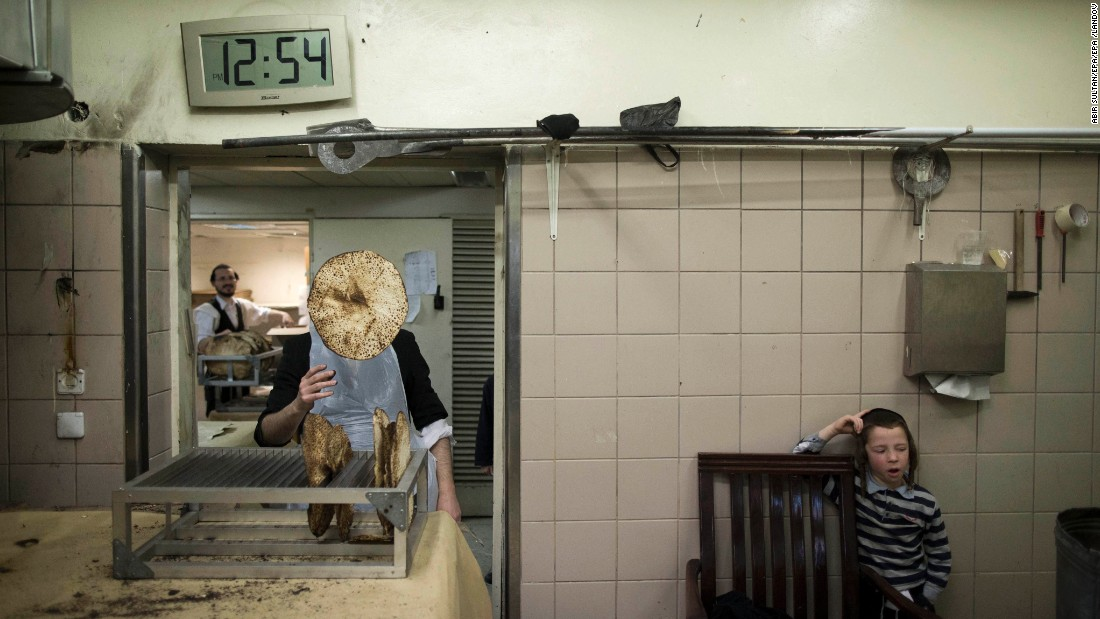 <strong>March 29:</strong> An Ultra-Orthodox Jewish man throws matzo into the air at a bakery in Jerusalem. Matzo, or unleavened bread, is traditionally eaten during the Jewish holiday of Passover.