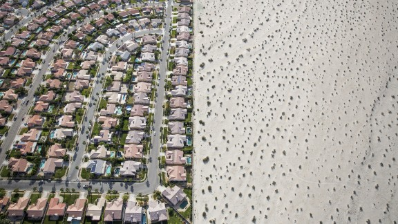 April 3: A housing development meets the edge of undeveloped desert in Cathedral City, California. California Gov. Jerry Brown imposed mandatory water restrictions on residents, businesses and farms in the drought-ravaged state, ordering cities and towns to reduce their usage by 25%.
