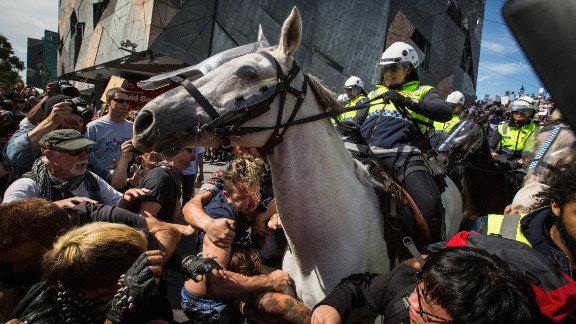 """April 4: Police in Melbourne try to break up a fight between two sets of protesters. """"Rally against racism"""" protesters were clashing with """"Reclaim Australia"""" protesters. The """"Reclaim Australia"""" protesters were rallying against what they called the """"Islamization"""" of the country."""