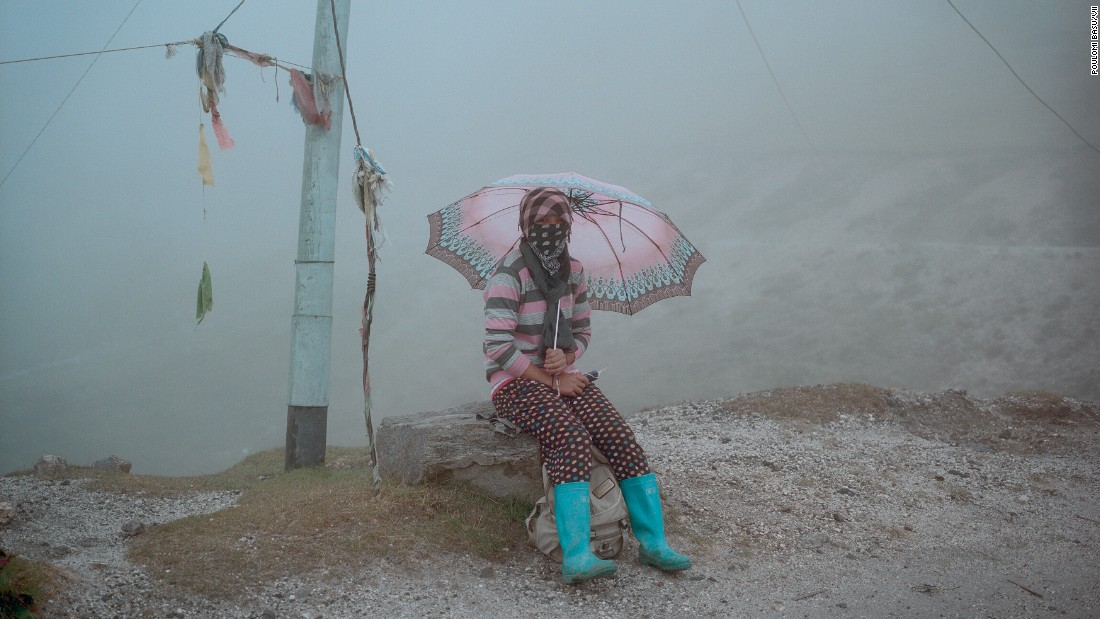 <strong>September 24: </strong>A person sits by the road near Sela Pass, a mountain pass in India's Arunachal Pradesh state.