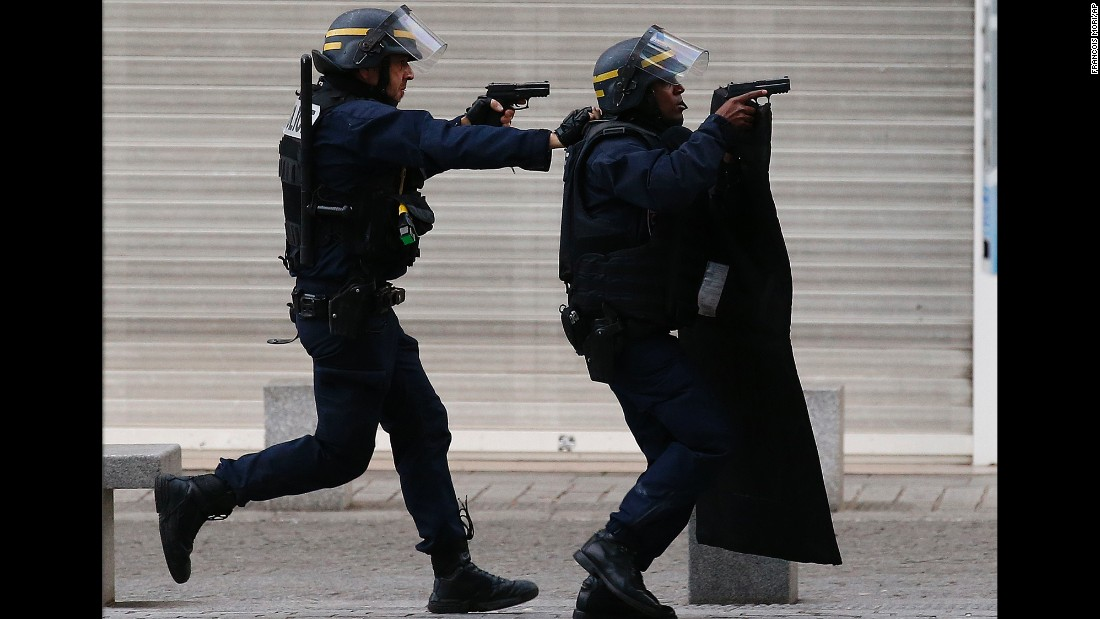 "<strong>November 18:</strong> Armed police raise their guns during an operation in the Paris suburb of Saint-Denis. French special forces <a href=""http://www.cnn.com/2015/11/18/world/gallery/french-raid-in-saint-denis/index.html"" target=""_blank"">raided a building in Saint-Denis,</a> looking for those behind the recent terrorist attacks in Paris. The hours-long ordeal ended with at least two suspects dead and eight detained."