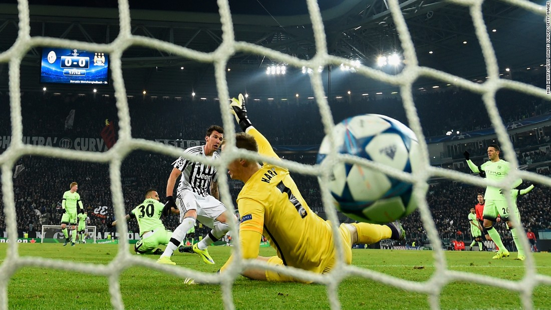 Mario Mandzukic scores the match-winner for Juventus as they beat Manchester City 1-0 to qualify for the Champions League knockout stages.