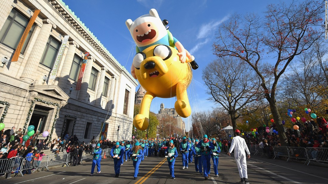 "A balloon of Finn and Jake from ""Adventure Time with Finn and Jake"" floats along the parade route."