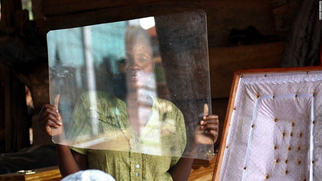 Badru Katumba placed third in the daily life category for a portrait of coffin maker Rebecca Nansubuga, who looks through a pane of glass that will be used to make the viewing panel on the front of a coffin.