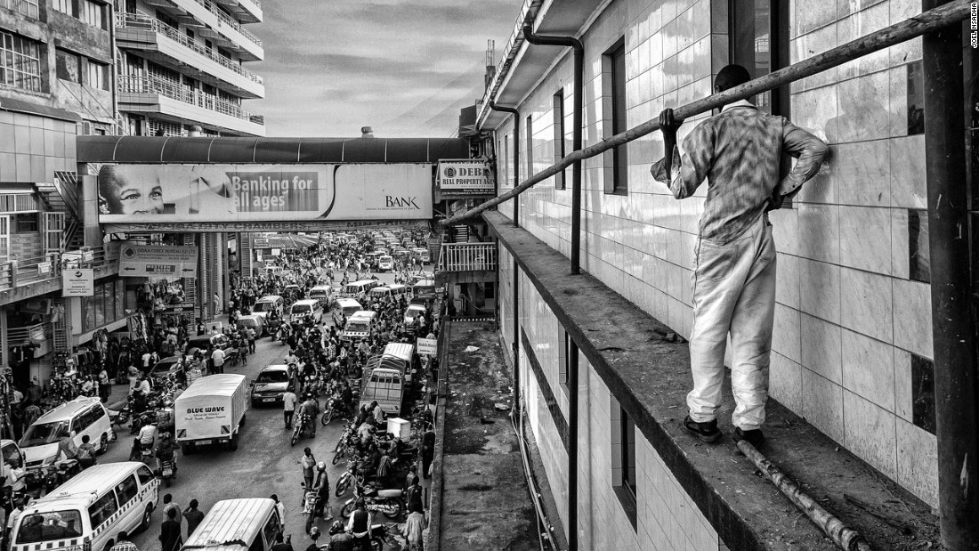 "<a href=""https://www.instagram.com/joelnsadha/"" target=""_blank"">Joel Nsadha </a>placed first in the daily life category for his photograph ""City Builder,"" in which he portrays Wasswa, a builder who is trying to balance on the side of a high-rise building in Kampala while also trying to keep his pants from falling down. He commutes into the city each day from Gayaza to work on building sites -- a job that earns him an average daily salary of 5,000 Ugandan shillings ($1.40)."