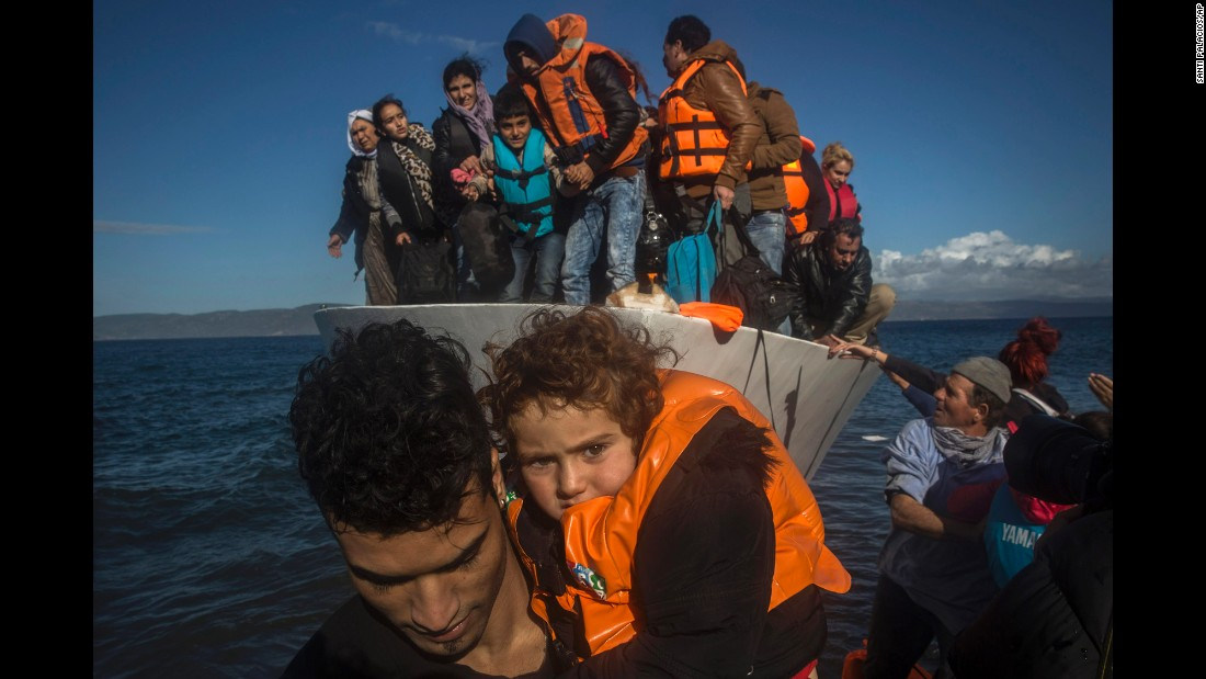 "Migrants disembark from a vessel after arriving at the Greek island of Lesbos on Thursday, November 26. About 5,000 migrants are reaching Europe each day along the so-called Balkan migrant route. <a href=""http://www.cnn.com/2015/09/03/world/gallery/europes-refugee-crisis/index.html"" target=""_blank"">See Europe's migration crisis in 25 photos</a>"