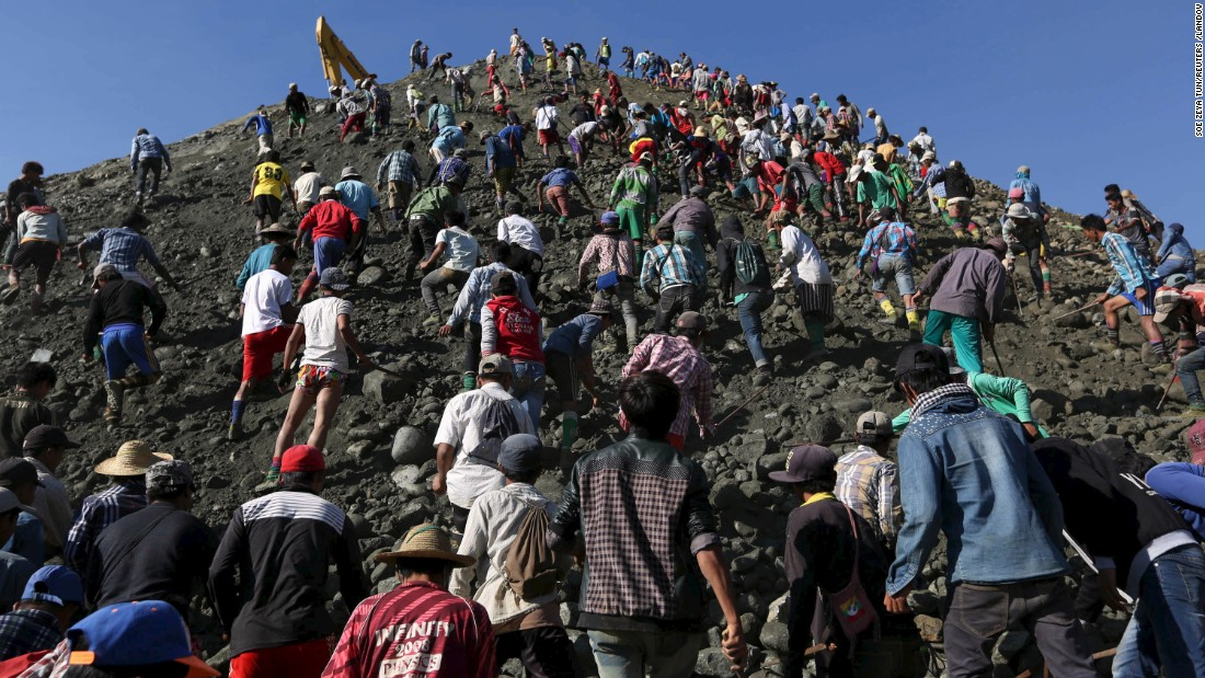 Miners search for jade stones at a mine dump in Myanmar's Kachin State on Wednesday, November 25.