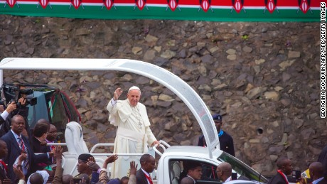 Pope Francis waves to a crowd at the University of Nairobi, Kenya, as he arrives to deliver a giant open-air mass on November 26, 2015.