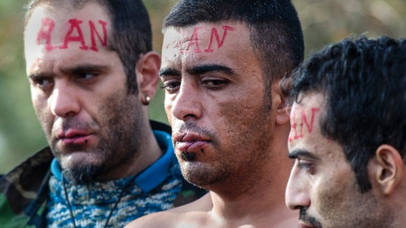 The 'Iranian' men are protesting the Macedonian government's decision to only allow Syrians, Iraqis and Afghans -- those fleeing war - to pass across the border.