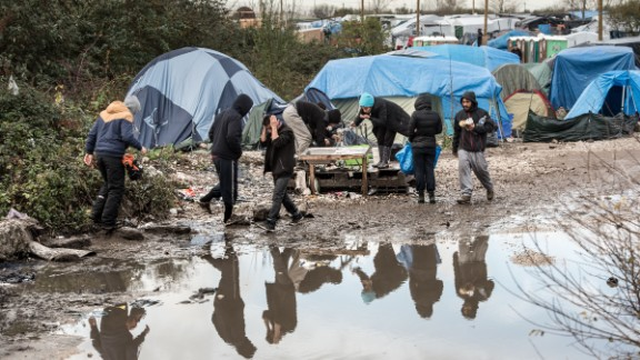 """Migrants and refugees live in squalid conditions in the migrant camp known as """"The Jungle."""""""