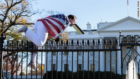 A person draped in an American flag jumped the fence on the North side of the White House, prompting a lockdown. He was apprehended by Secret Service.