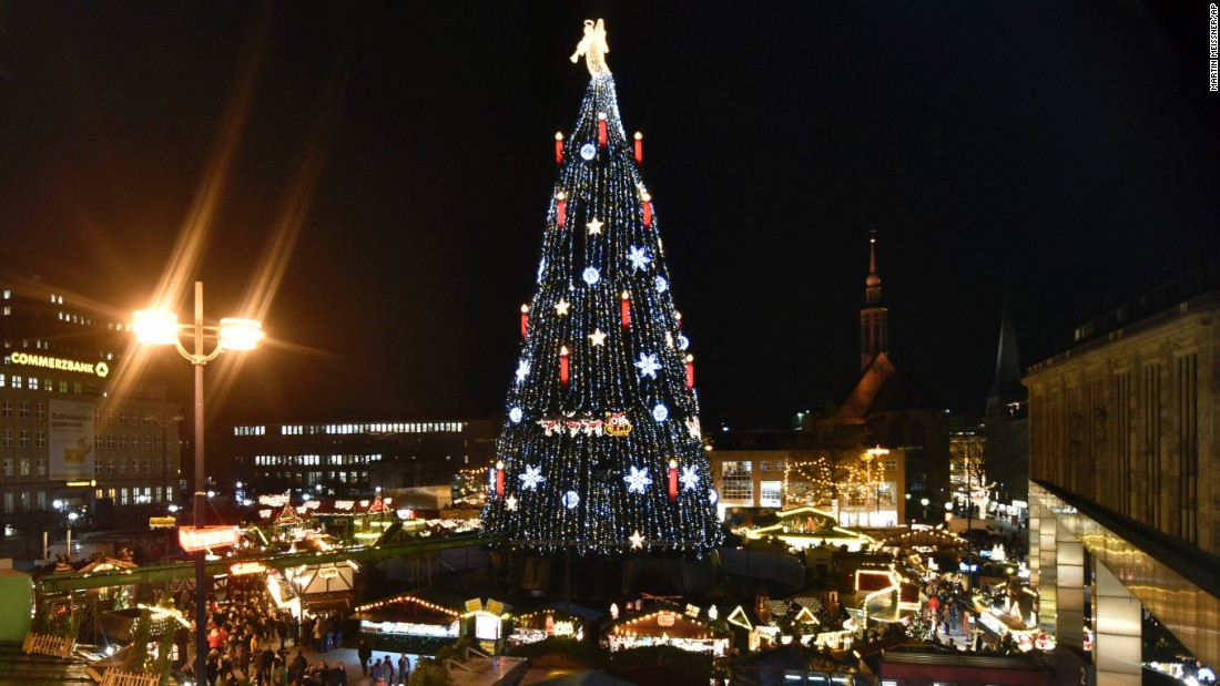 Germany's biggest Christmas tree is illuminated with 48,000 lights at the traditional holiday market in Dortmund. The 45-meter (148-foot) tree was built using 1,700 smaller trees.