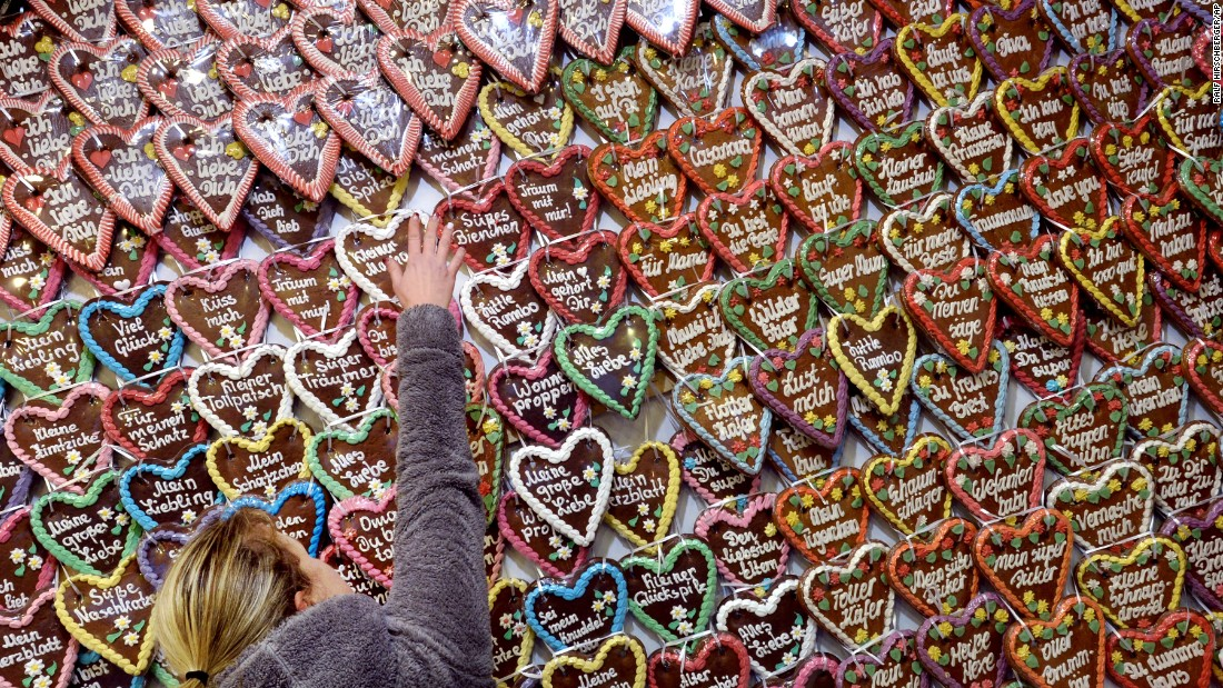A vendor arranges hundreds of gingerbread hearts at the Christmas market in Potsdam, Germany.