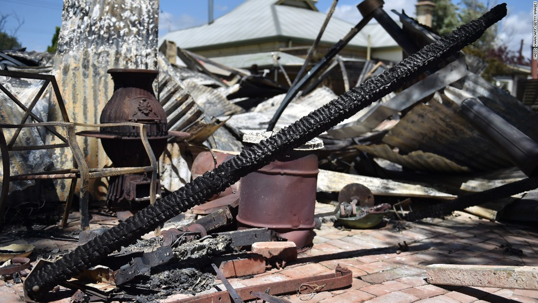 Damaged belongings outside a completely gutted property following a bushfire north of Adelaide, South Australia, on November 26, 2015. For a second day hundreds of firefighters battled a devastating blaze that has left two dead and at least 13 in hospital.