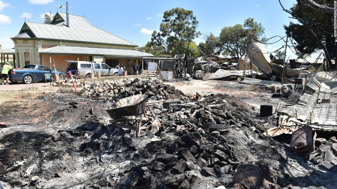Residents assess the damage caused to their property by bushfires that wrecked the town of Freeling on November 26.