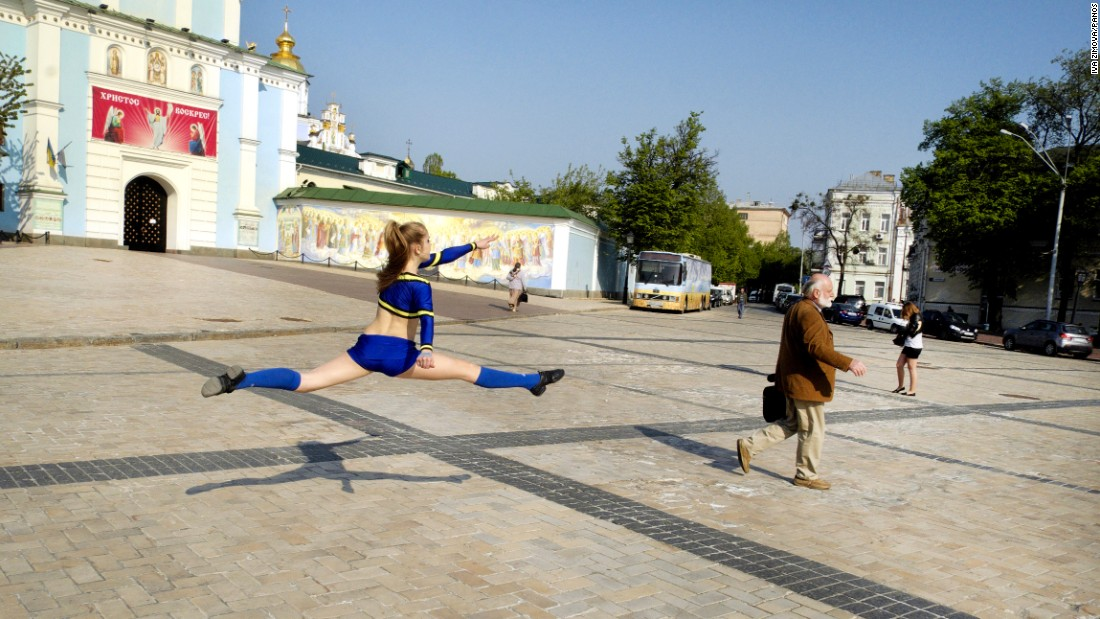 <strong>April 30: </strong>A girl practices gymnastic exercises on Mikhailovskaya Square in Kiev, Ukraine.