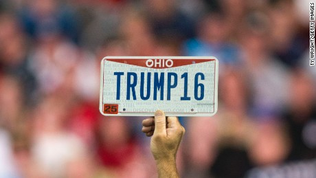 "COLUMBUS, OH - NOVEMBER 23:  A supporter holds up a personalized license plate labeled ""Trump16"" during a campaign rally for Republican presidential candidate Donald Trump at the Greater Columbus Convention Center on November 23, 2015 in Columbus, Ohio. Trump spoke about immigration and Obamacare, among other topics, to around 14,000 supporters at the event.  (Photo by Ty Wright/Getty Images)"