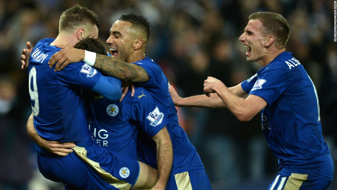 Vardy who has now scored in 11 straight games is mobbed by his teammates after scoring in the 1-1 draw.