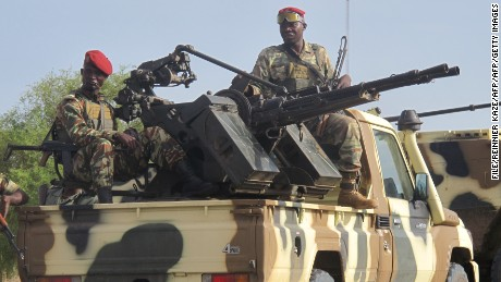 Cameroonian army soldiers patrol the country's Far North Region as part of a deployment against against Boko Haram in June 2014.