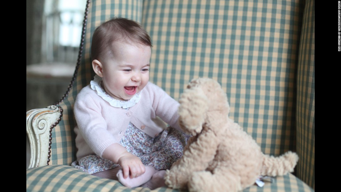 Princess Charlotte plays with a stuffed dog in this photo taken by her mother in November 2015.