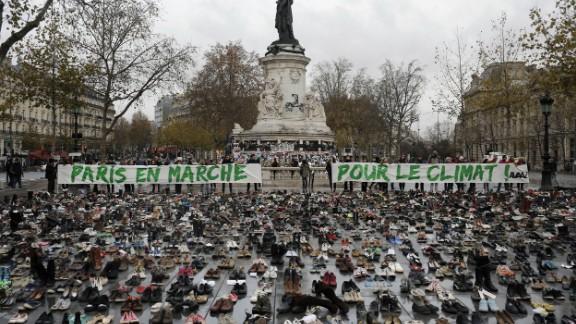 Hundreds of pairs of shoes are displayed at the Place de la République.
