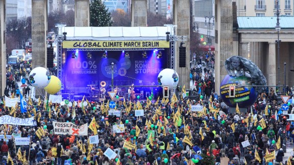Climate activists march in front of the Brandenburger Tor in Berlin.