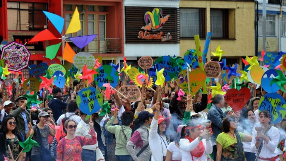 People take part in the Global Climate March in Bogota, Colombia.