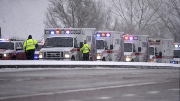 Colorado Springs rescue personnel stand ready near the scene.