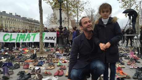 Frederic Vivenot brought his 7-year-old daughter, Chloe, to leave her pink sneakers at the Place de la République in Paris.