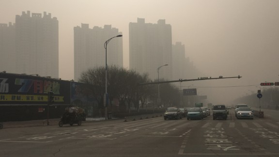 Roads and buildings in Baoding, China's most polluted city, are cloaked in thick smog on November 30, where the air quality index (AQI) has reached a 'hazardous' level.