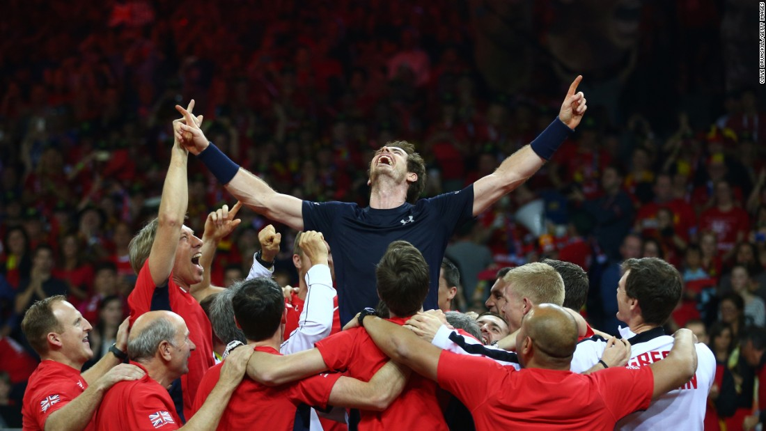"Members of the British Davis Cup team surround Andy Murray after he defeated Belgium's David Goffin <a href=""http://www.cnn.com/2015/11/29/sport/great-britain-davis-cup-title-tennis/"" target=""_blank"">to win the tennis tournament</a> Sunday, November 29, in Ghent, Belgium. It's the first time Great Britain has won the Davis Cup since 1936."