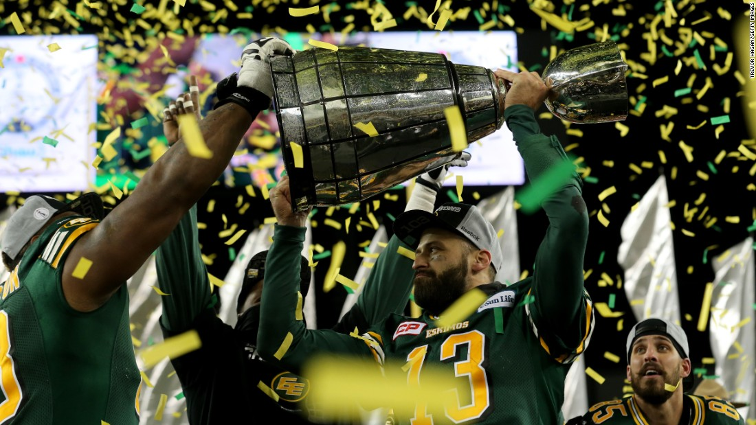 Edmonton quarterback Mike Reilly (No. 13) holds the Grey Cup after the Eskimos defeated Ottawa to win the Canadian Football League title on Sunday, November 29. It's Edmonton's 14th Grey Cup victory.