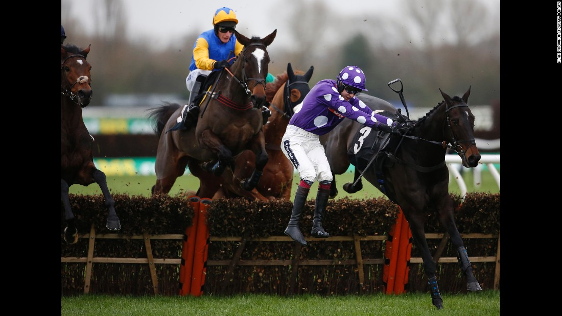 Aidan Coleman falls from his horse, Acajou Des Bieffes, during a hurdle race in Newbury, England, on Thursday, November 26.