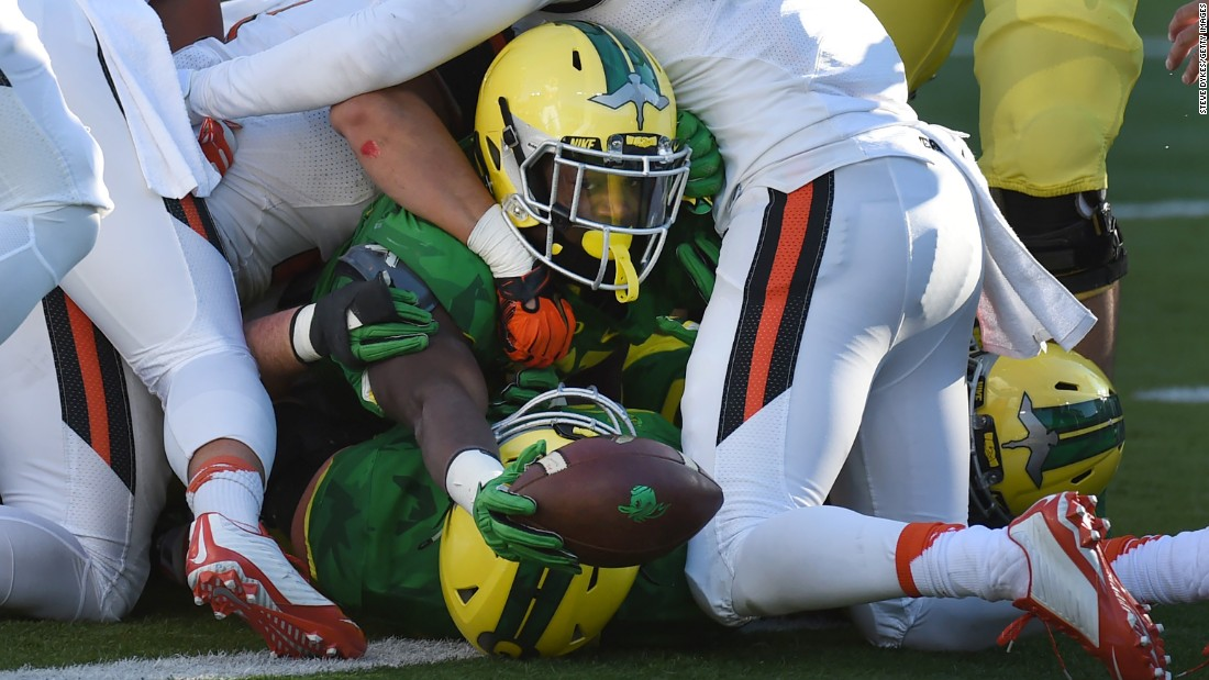 "Oregon running back Royce Freeman reaches the ball over the goal line during a home game against Oregon State on Friday, November 27. Oregon won the ""Civil War"" 52-42."