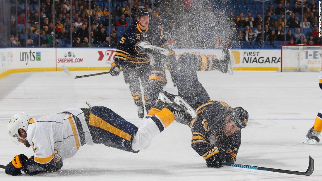 Nashville's Mike Fisher, left, collides with Buffalo's Ryan O'Reilly during an NHL game in Buffalo, New York, on Wednesday, November 25.