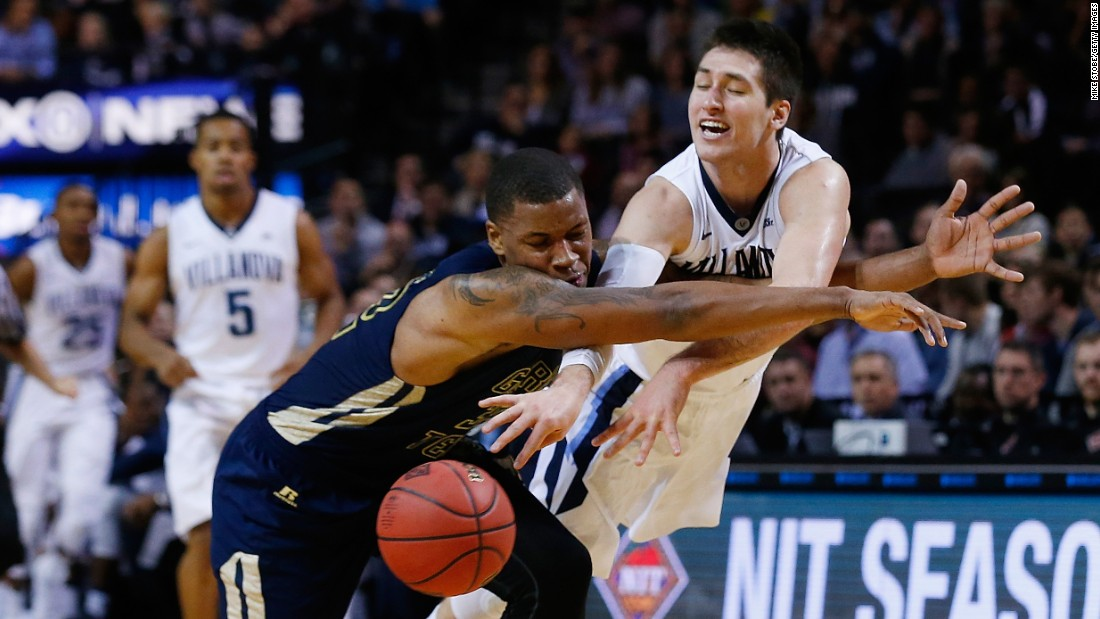 Georgia Tech's Nick Jacobs, left, and Villanova's Ryan Arcidiacono chase a loose ball during the NIT Championship game in New York on Friday, November 27. Villanova won 69-52.